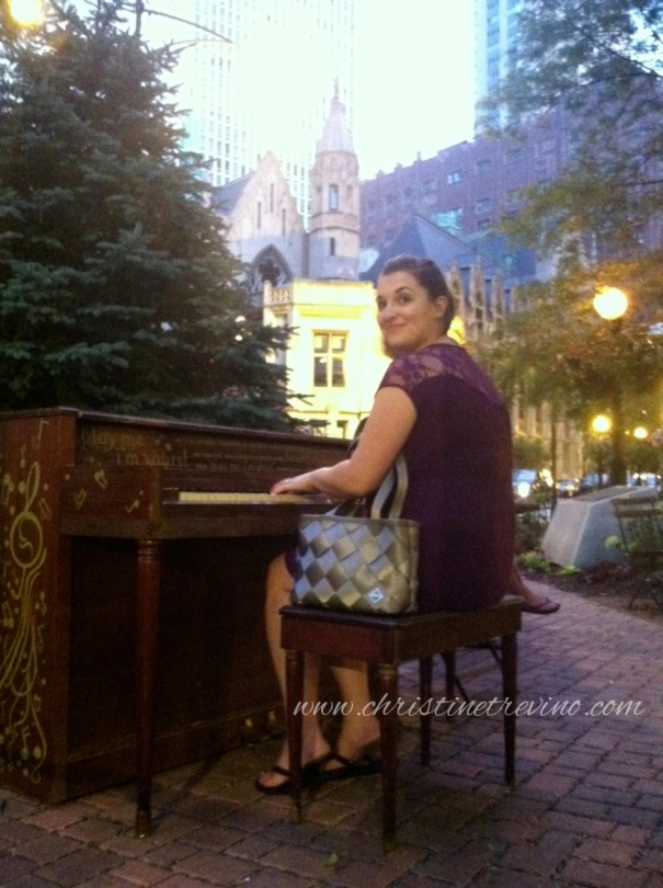 Playing an outdoor piano outside the Argo Tea near our hotel.